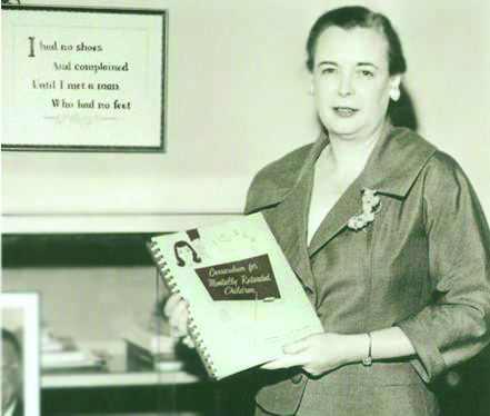 Dr. Gertrude Barber with textbook