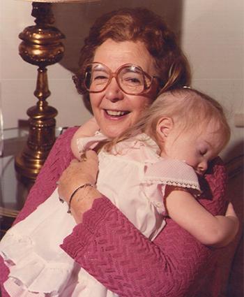 Dr. Gertrude Barber cradling baby